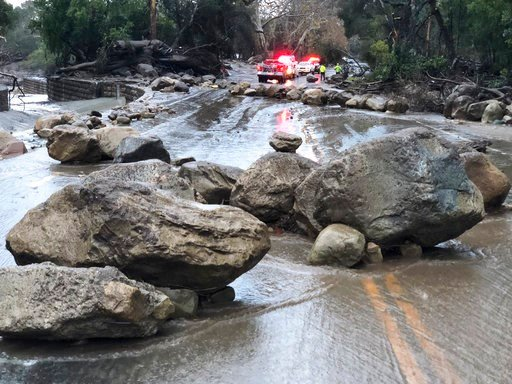 (Mike Eliason/Santa Barbara County Fire Department via AP). In this photo provided by Santa Barbara County Fire Department,   mud and debris flow on the roadway due to heavy rain in Montecito. Calif., Tuesday, Jan. 9, 2018.   Heavy rains pounding South...
