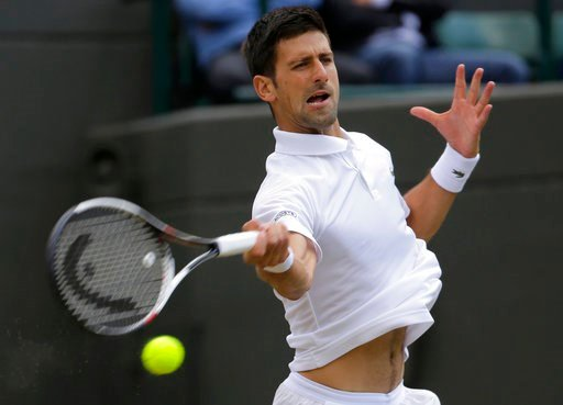 (AP Photo/Alastair Grant, File). FILE - In this July 12, 2017, file photo, Serbia's Novak Djokovic returns to Czech Republic's Tomas Berdych during their Men's Singles Quarterfinal Match on day nine at the Wimbledon Tennis Championships in London. Djok...