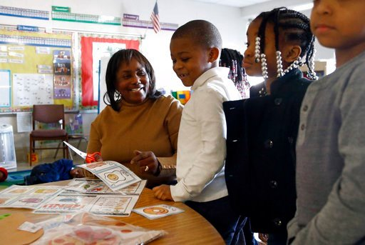 (AP Photo/Patrick Semansky). In this Jan. 9, 2018 photo, Maxine Winbush, left, works with pre-kindergarten student in a classroom at Lakewood Elementary School in Baltimore. At Lakewood, a 1960s-era building in an East Baltimore neighborhood marred by ...