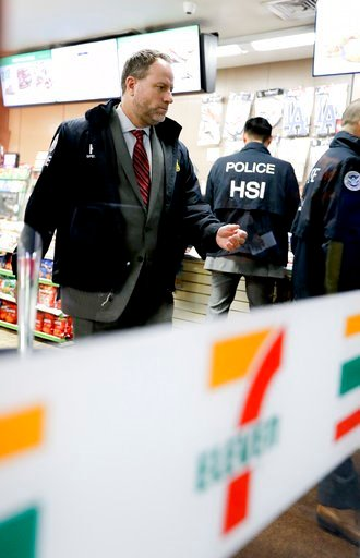 (AP Photo/Chris Carlson). Christopher Kuemmerle, a group supervisor for U.S. immigration and Customs Enforcement's Homeland Security Investigations unit watches as agents serve an employment audit notice at a 7-Eleven convenience store Wednesday, Jan. ...