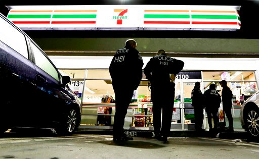 (AP Photo/Chris Carlson). U.S. Immigration and Customs Enforcement agents serve an employment audit notice at a 7-Eleven convenience store Wednesday, Jan. 10, 2018, in Los Angeles. Agents said they targeted about 100 7-Eleven stores nationwide Wednesda...