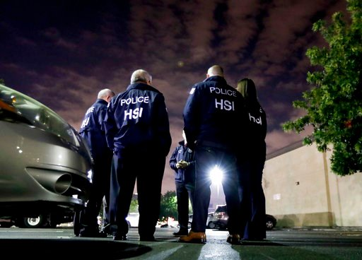 (AP Photo/Chris Carlson). U.S. Immigration and Customs Enforcement agents gather before serving a employment audit notice at a 7-Eleven convenience store Wednesday, Jan. 10, 2018, in Los Angeles. Agents said they targeted about 100 7-Eleven stores nati...