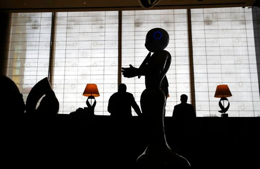 (AP Photo/John Locher). In this Nov. 15, 2017, photo, a robot named Pepper stands in the lobby of the Mandarin Oriental in Las Vegas. Pepper is programmed to interact with guests and answer pre-programmed questions.