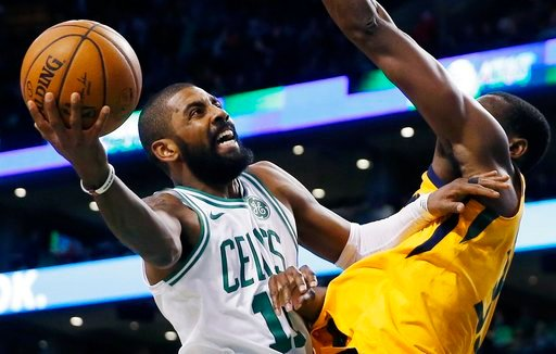 (AP Photo/Michael Dwyer, File). FILE - In this Dec. 15, 2017, file photo, Boston Celtics' Kyrie Irving (11) shoots against Utah Jazz's Ekpe Udoh during the fourth quarter of an NBA basketball game in Boston. When the Boston Celtics and Philadelphia 76e...