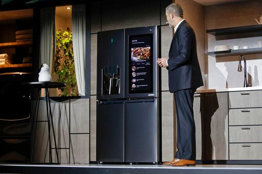 (AP Photo/Jae C. Hong). LG's David Vander Waal introduces the InstaView ThinQ smart refrigerator during a news conference at CES International, Monday, Jan. 8, 2018, in Las Vegas.