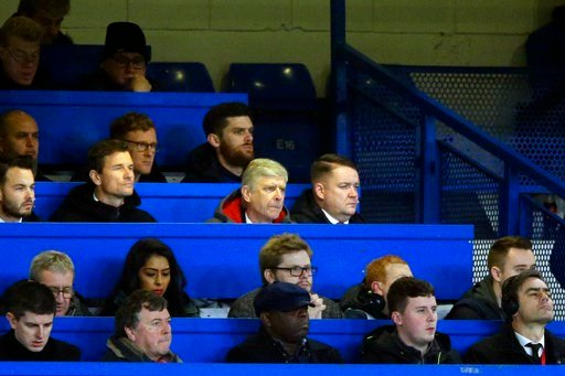 (AP Photo/Alastair Grant). Arsenal manager Arsene Wenger, center, looks out from the press box during the English League Cup semifinal, first leg, soccer match between Chelsea and Arsenal at Stamford Bridge stadium in London, Wednesday, Jan. 10, 2018.