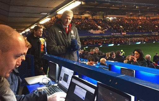 (Matt McGeehan/PA via AP). Arsenal manager Arsene Wenger moves past the media section towards his seat in the stands, before the English League Cup semifinal, first leg, soccer match between Chelsea and Arsenal at Stamford Bridge stadium in London, Wed...
