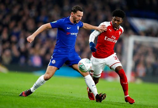 (AP Photo/Kirsty Wigglesworth). Chelsea's Danny Drinkwater, left, vies for the ball with Arsenal's Ainsley Maitland-Niles during the English League Cup semifinal, first leg, soccer match between Chelsea and Arsenal at Stamford Bridge stadium in London,...