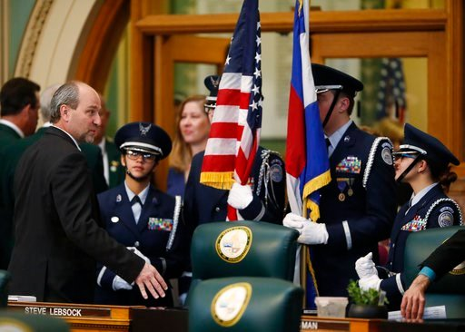 (AP Photo/David Zalubowski). State Rep. Steve Lebsock, D-Thornton, left, chats with members of the William Mitchell High School JROTC unit from Colorado Springs, Colo., before the unit carried in the flags to mark the opening of the 2018 legislative se...