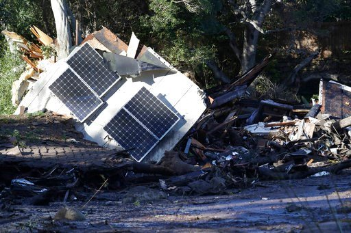 (AP Photo/Marcio Jose Sanchez). Solar panels from a destroyed home and debris are shown in Montecito, Calif., Wednesday, Jan. 10, 2018. Dozens of homes were swept away or heavily damaged and several people were killed Tuesday as downpours sent mud and ...