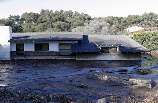 (AP Photo/Marcio Jose Sanchez). A home sits in mud and water in Montecito, Calif., Wednesday, Jan. 10, 2018. Dozens of homes were swept away or heavily damaged and several people were killed Tuesday as downpours sent mud and boulders roaring down hills...