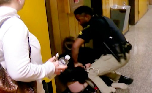 (KATC-TV via AP). In this Monday, Jan. 8, 2018, image made from a video provided by KATC-TV middle-school English teacher Deyshia Hargrave is handcuffed by a city marshal.