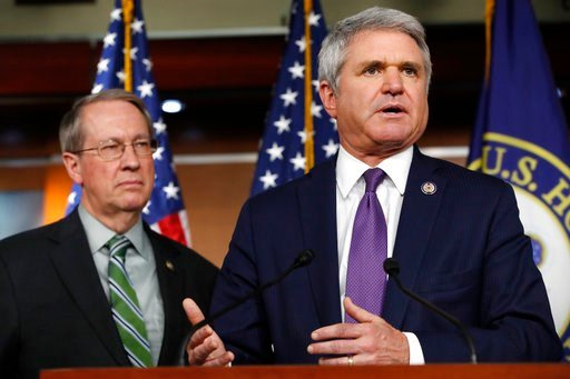 (AP Photo/Jacquelyn Martin). House Judiciary Committee Chairman Rep. Bob Goodlatte, R-Va., left, listens as House Homeland Security Committee Chairman Rep. Michael McCaul, R-Texas, speaks during a news conference on their immigration bill.