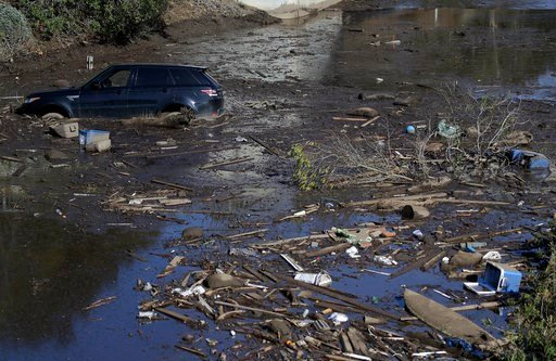 (AP Photo/Marcio Jose Sanchez). A car sits stranded in flooded water on Highway 101 in Montecito, Calif., Wednesday, Jan. 10, 2018. Dozens of homes were swept away or heavily damaged and several people were killed Tuesday as downpours sent mud and boul...