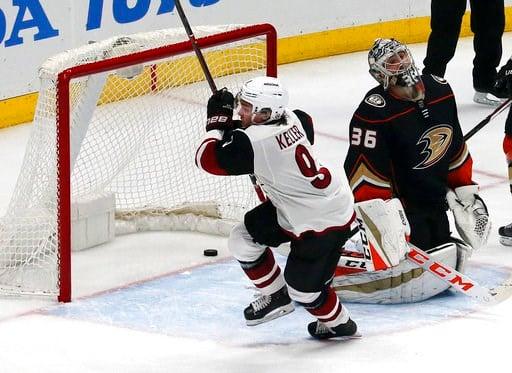(AP Photo/Reed Saxon). Arizona Coyotes center Clayton Keller (9) celebrates his goal past Anaheim Ducks goalie John Gibson (36) in the third period of an NHL hockey game in Anaheim, Calif., Sunday, Dec. 31, 2017.