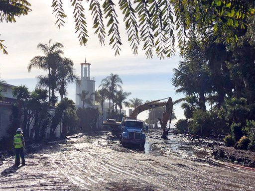 (Mike Eliason/Santa Barbara County Fire Department via AP). This photo provided by the Santa Barbara County Fire Department shows the cleanup of mud and debris in front of the Coral Casino and Biltmore Hotel along Channel Drive in Montecito, Calif.