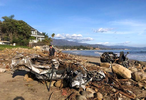 (Mike Eliason/Santa Barbara County Fire Department via AP). This photo provided by the Santa Barbara County Fire Department shows the wreckage of two autos on the beach that were carried by floodwaters down Montecito Creek Tuesday.