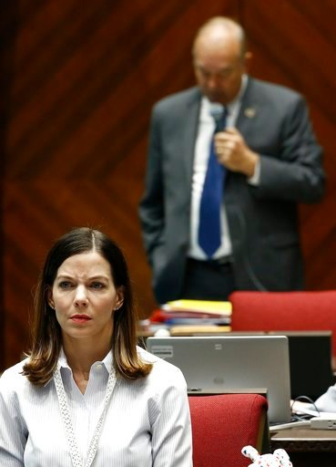 (AP Photo/Ross D. Franklin). Rep. Michelle Ugenti-Rita, left, R-Scottsdale, listens to Rep. Don Shooter, right, R-Yuma, as he reads a statement regarding sexual harassment and other misconduct complaints made against him by Ugenti-Rita and others, as h...