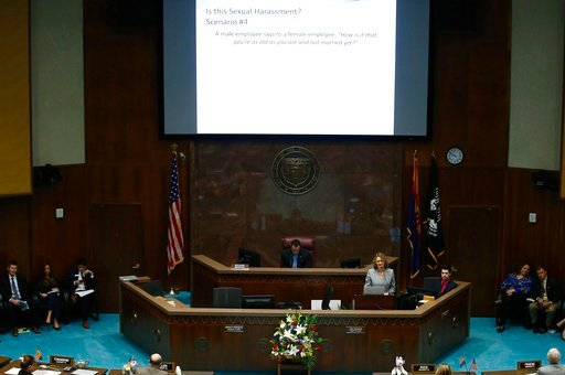 (AP Photo/Ross D. Franklin). Rebekah Browder, chief counsel for the Arizona Civil Rights Division of the Arizona Attorney General's Office, stands at a podium as she gives a presentation as Arizona House members receive mandatory sexual harassment and ...