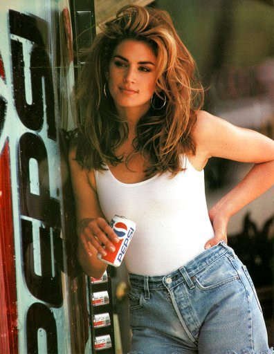 (Pepsi via AP). This image released by Pepsi shows actress-model Cindy Crawford in a scene from her 1992 iconic Super Bowl Pepsi commercial. Crawford returns for another Pepsi commercial which will premiere during Super Bowl LII on Feb. 4. The new ad i...