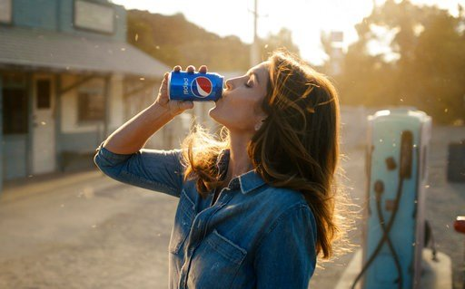 (Pepsi via AP). This photo released by Pepsi shows actress-model Cindy Crawford in a scene from her 2018 Pepsi commercial which will premiere during Super Bowl LII on Feb. 4. The new ad includes her son, Presley Walker Gerber, as well as footage from M...