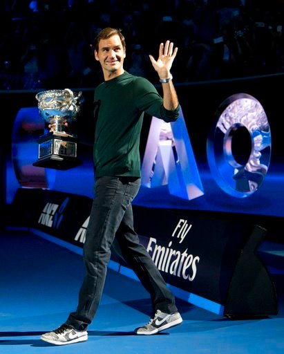 (AP Photo/Mark Baker). Defending men's singles champion Switzerland's Roger Federer waves to the crowd during a ceremony for the official draw at the Australian Open tennis championships in Melbourne, Australia Thursday, Jan. 11, 2018.