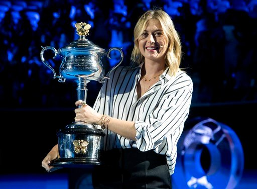 (AP Photo/Mark Baker). Former ladies single's champion Russia's Maria Sharapova poses for a photo with the Daphne Akhurst Memorial Cup on Margaret Court Arena during the ceremony for the official draw at the Australian Open tennis championships in Melb...