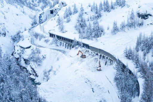 (Dominic Steinmann/Keystone via AP). A digger at work where an avalanche has blocked the road between Taesch and Zermatt, Wednesday Jan. 10, 2018. Swiss authorities have closed ski slopes, hiking trails, cable cars, roads into the town of Zermatt amid ...