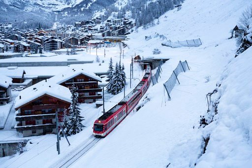 (Dominic Steinmann/Keystone via AP). The first passenger train is leaving the train station towards Taesch, in Zermatt, Switzerland, Wednesday, Jan. 10, 2018. Due to heavy snowfall and rain showers, Zermatt was only reachable by air. In the meantime th...