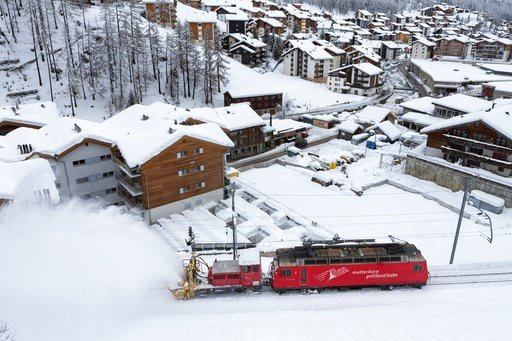 (Dominic Steinmann/Keystone via AP). A snow blower on a train clears snow from the rail track in Zermatt, Switzerland, Wednesday, Jan. 10, 2018. Due to heavy snowfall and rain showers, Zermatt can only be reached by air. Swiss authorities have closed r...