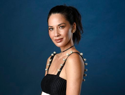 (Photo by Chris Pizzello/Invision/AP, File). FILE - In this July 21, 2017 file photo, actress Olivia Munn poses for a portrait at Comic-Con International in San Diego. Munn is hosting the Critics' Choice Awards on Thursday, Jan. 11, 2018.