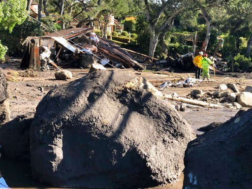 (Mike Eliason/Santa Barbara County Fire Department via AP). In this photo provided by Santa Barbara County Fire Department, shows destroyed homes dot the landscape along San Ysidro Creek near East Valley Road in Montecito, Calif. on Wednesday, Jan. 10,...