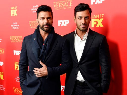 "(Photo by Chris Pizzello/Invision/AP, File). FILE - In this Jan. 8, 2018, file photo, Ricky Martin, left, a cast member in ""The Assassination of Gianni Versace: American Crime Story,"" poses with Jwan Yosef at a special screening in Los Angeles. Martin ..."