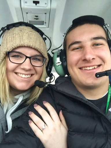 (Ed Becker via AP). In this Jan. 7, 2018 photo provided by Ed Becker, Gavin Becker and his long-time girlfriend Olivia Toft fly over the spot where he proposed on Eight Crow Wing Lake near Nevis, Minn. Becker had his family's help etching out the big q...