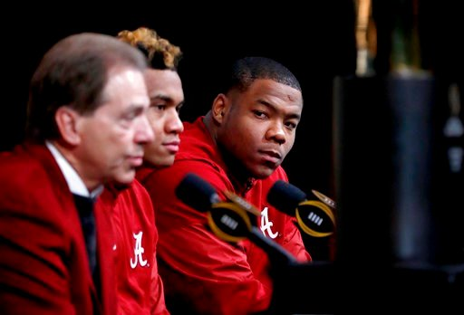 (AP Photo/David Goldman). Alabama defensive lineman Da'Ron Payne, right, looks on during a press conference with quarterback Tua Tagovailoa, center, and head coach Nick Saban as the NCAA college football championship trophy is displayed in Atlanta, Tue...