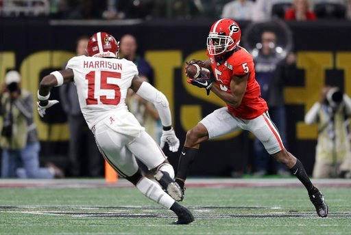 (AP Photo/David J. Phillip). Georgia's Terry Godwin catches a pass in front of Alabama's Ronnie Harrison during the first half of the NCAA college football playoff championship game Monday, Jan. 8, 2018, in Atlanta.