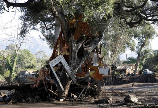 (AP Photo/Marcio Jose Sanchez). A structure, damaged from mudslides, sits slammed against a tree in Montecito, Calif., Thursday, Jan. 11, 2018.