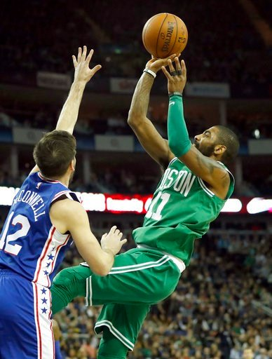 (AP Photo/Kirsty Wigglesworth). Philadelphia 76ers guard T.J. McConnell, left, tries to block a shot by Boston Celtics guard Kyrie Irving during an NBA basketball game between the Boston Celtics and the Philadelphia 76ers at the O2 Arena in London, Thu...