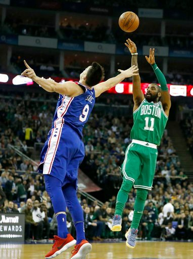 (AP Photo/Kirsty Wigglesworth). Philadelphia 76ers forward Dario Saric, left, goes up to block Boston Celtics guard Kyrie Irving as he shoots during an NBA basketball game between the Boston Celtics and the Philadelphia 76ers at the O2 Arena in London,...