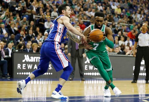 (AP Photo/Kirsty Wigglesworth). Boston Celtics guard-forward Jaylen Brown, right, dribbles around Philadelphia 76ers guard-forward JJ Redick during an NBA basketball game between the Boston Celtics and the Philadelphia 76ers at the O2 Arena in London, ...