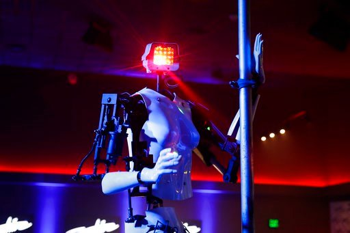 (AP Photo/Jae C. Hong). A pole-dancing robot built by British artist Giles Walker performs at a gentlemen's club Monday, Jan. 8, 2018, in Las Vegas. The event was held to coincide with CES International.