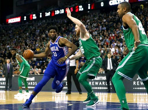 (Simon Cooper/PA via AP). Philadelphia 76ers' Joel Embiid, left, and Boston Celtics' Aron Bynes in action during the NBA London Game 2018 at the O2 Arena in London, Thursday Jan. 11, 2018.