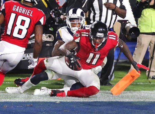 (Curtis Compton/Atlanta Journal-Constitution via AP). Atlanta Falcons wide receiver Julio Jones catches a touchdown pass past Los Angeles Rams defender John Johnson III during the fourth quarter of an NFL football wild-card playoff game Saturday, Jan. ...