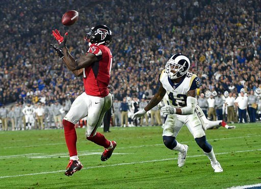 (AP Photo/Kelvin Kuo). Atlanta Falcons wide receiver Julio Jones, left, catches a touchdown pass ahead of Los Angeles Rams strong safety John Johnson during the second half of an NFL football wild-card playoff game Saturday, Jan. 6, 2018, in Los Angeles.