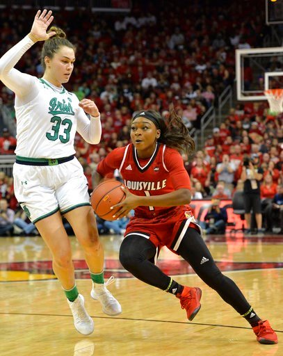 (AP Photo/Timothy D. Easley). Louisville guard Dana Evans (1) drives around the defense of Notre Dame forward Kathryn Westbeld (33) during the first half of an NCAA college basketball game, Thursday, Jan. 11, 2018, in Louisville, Ky.