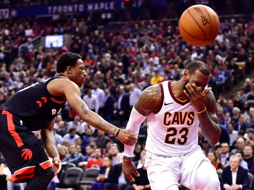 (Frank Gunn/The Canadian Press via AP). Cleveland Cavaliers forward LeBron James (23) reacts after being fouled by Toronto Raptors guard DeMar DeRozan, left, during the second half of an NBA basketball game Thursday, Jan. 11, 2018, in Toronto.