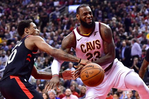 (Frank Gunn/The Canadian Press via AP). Cleveland Cavaliers forward LeBron James (23) reacts after being fouled by Toronto Raptors guard DeMar DeRozan (10) during the second half of an NBA basketball game Thursday, Jan. 11, 2018, in Toronto.