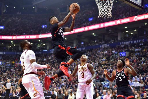 (Frank Gunn/The Canadian Press via AP). Toronto Raptors guard Delon Wright (55) goes up for a basket past Cleveland Cavaliers guard Dwyane Wade (9) and guard Isaiah Thomas (3) as Raptors forward OG Anunoby (3) watches during the first half of an NBA ba...