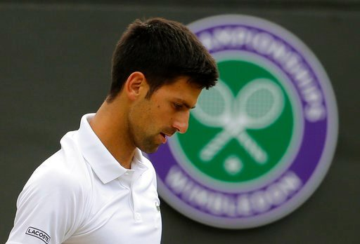 (AP Photo/Alastair Grant,File). FILE - In this July 12, 2017 file photo, Serbia's Novak Djokovic pauses during his match against Czech Republic's Tomas Berdych in their Men's Singles Quarterfinal Match on day nine at the Wimbledon Tennis Championships ...