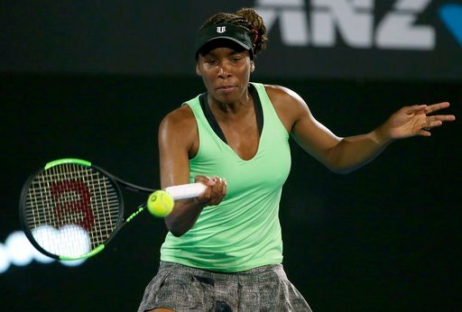 (AP Photo/Rick Rycroft). Venus Williams of the U.S. plays a forehand to Germany's Angelique Kerber in their women's singles match at the Sydney International tennis tournament in Sydney, Tuesday, Jan. 9, 2018.
